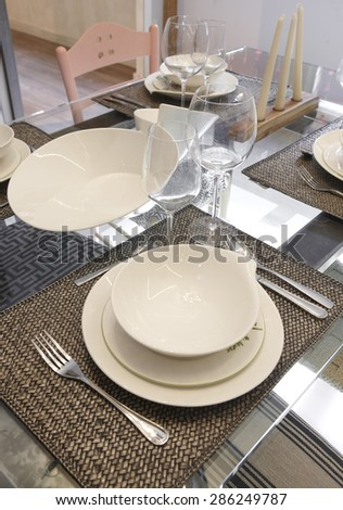 Crockery set over a table ready to be served. Vertical - stock photo