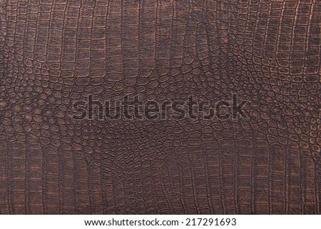 Crocodile skin leather, bronze background - stock photo