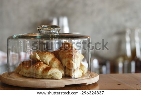 croissant in glass dessert jar at coffee shop - stock photo