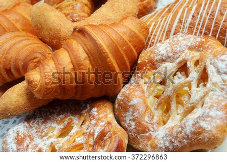 croissants and various pastries baking - stock photo