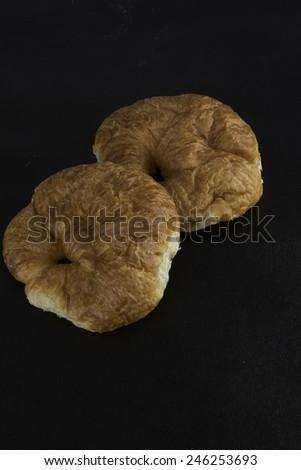 Croissants on black background/Croissants/Golden brown baked croissants on black background - stock photo