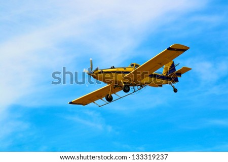 Crop Duster in Straight and level flight. - stock photo