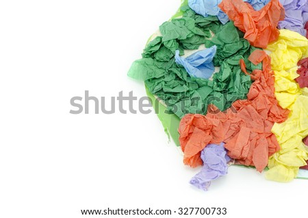 cropped abstract image of vertical green, orange, yellow and purple color paper on card board isolated on white background - stock photo