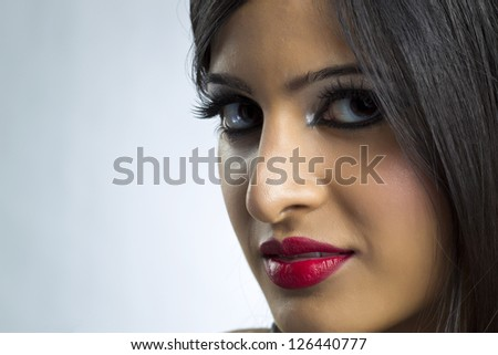 Cropped image of a beautiful woman's face wearing make up - stock photo