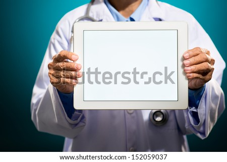Cropped image of a doctor with a tablet with blank screen on the foreground - stock photo