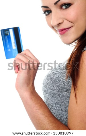 Cropped image of a pretty woman posing sideways with a cash card in hand. - stock photo
