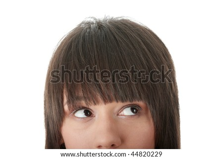 Cropped image of a young girl with her eyes looking away right isolated on white background - stock photo