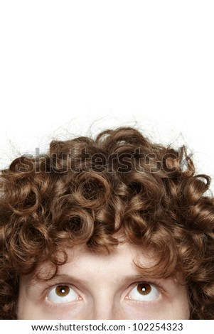 Cropped image of a young male with his eyes looking up, isolated on white background - stock photo
