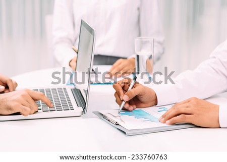 Cropped image of business people having meeting in the office - stock photo