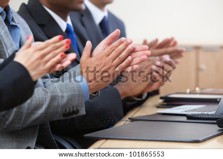 Cropped image of businesspeople clapping - stock photo