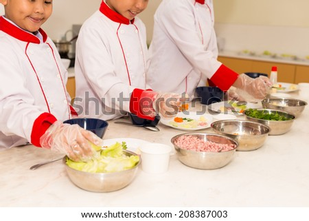 Cropped image of children having cooking class - stock photo