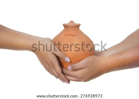 Cropped image of couple holding piggy bank over white background - stock photo