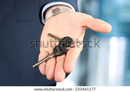 Cropped image of estate agent giving house keys in office - stock photo
