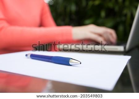 Cropped image of female using laptop. - stock photo