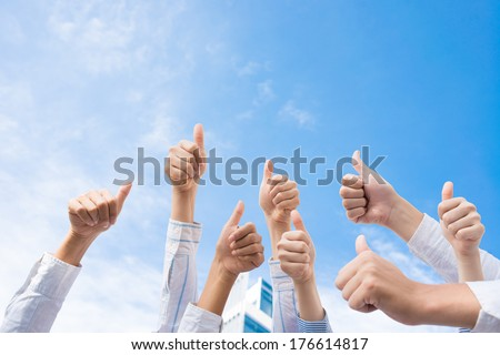 Cropped image of human hands in the air thumbing up over the sky  - stock photo