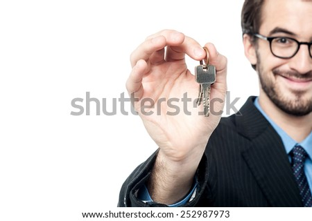 Cropped image of landlord offering the house keys  - stock photo
