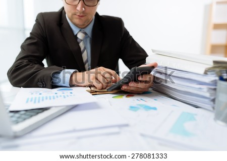 Cropped image of male accountant working with papers - stock photo