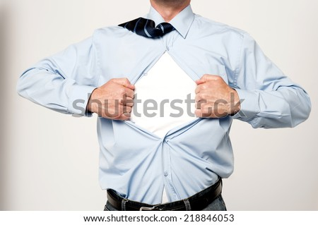 Cropped image of male executive tearing his shirt off - stock photo