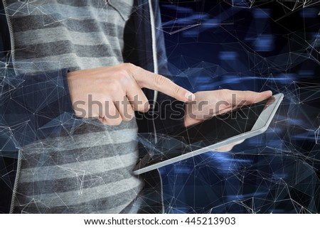 Cropped image of man using tablet against black glowing design - stock photo