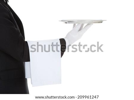 Cropped image of waiter holding empty tray over white background - stock photo