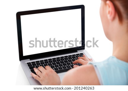 Cropped image of young woman using laptop over white background - stock photo