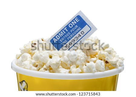 Cropped images of popcorn cup and movie ticket - stock photo