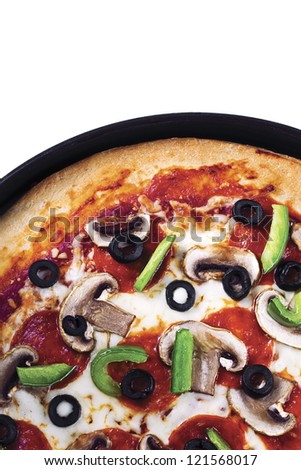 Cropped shot of a pepperoni pizza in pizza pan. - stock photo