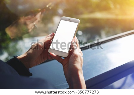 Cropped shot view of a woman's hands holding mobile phone with empty copy space screen for your text message or advertising content, young female person chatting on cell telephone during work break  - stock photo
