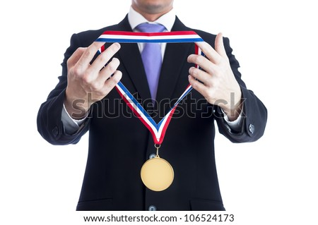 Cropped torso of man wearing black suit and awarding blank sports gold medal. - stock photo