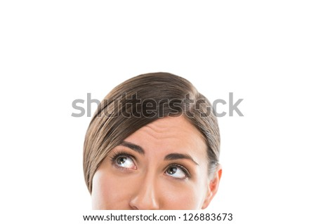 Cropped view of a beautiful young lady face over white background - stock photo