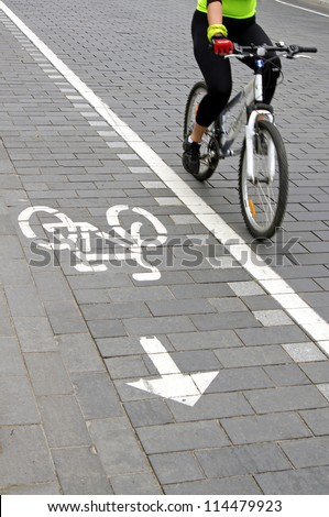 Cropped view of a bicyclist. - stock photo