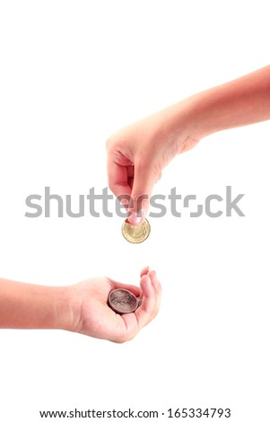Cropped view of a hand giving a coin to another person - stock photo