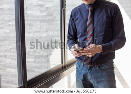 Cropped view of Businessman holding the phone. - stock photo