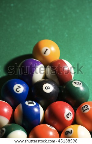 Cropped view of racked pool balls on a pool table. Vertical shot. - stock photo