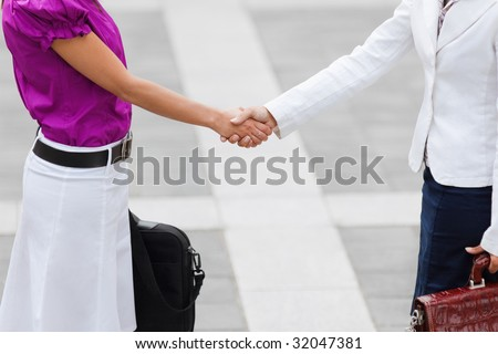 cropped view of two business women shaking hands. Copy space - stock photo