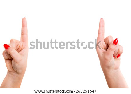 Cropped view of two hands pointing their index fingers upwards - stock photo