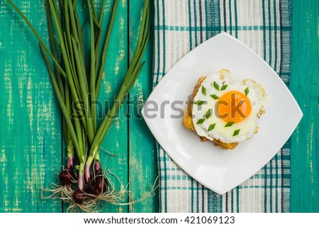 Croque-Madame, a French sandwich with greens and berry juice for breakfast. Wooden table. Top view - stock photo