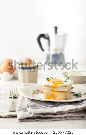 Croque madame, egg, ham, cheese sandwich, traditional French cuisine. Breakfast table. - stock photo