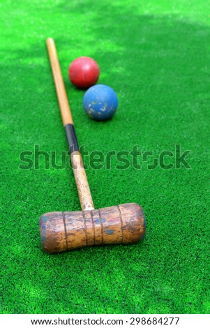 Croquet equipment on artificial grass , mallet and balls - stock photo