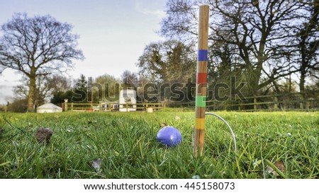 Croquet equipment on the grass - stock photo