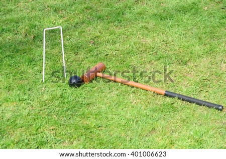 Croquet Hoop mallet and ball in landscape - stock photo