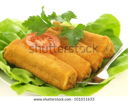 Croquette dish with lettuce and tomato slice - stock photo