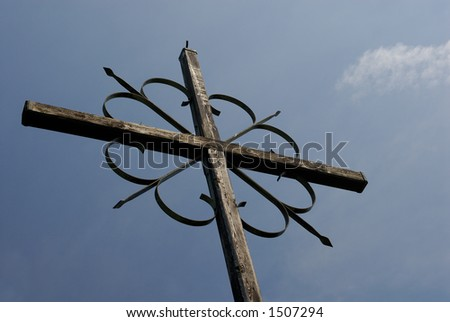Cross against blue sky - stock photo