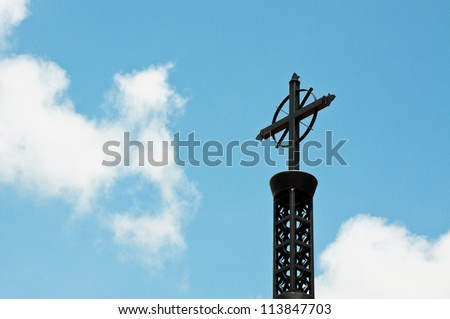 Cross against the Blue Sky - stock photo
