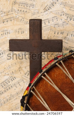 Cross and drum with a musical background - stock photo