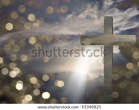 Cross and light beams down from sky - stock photo