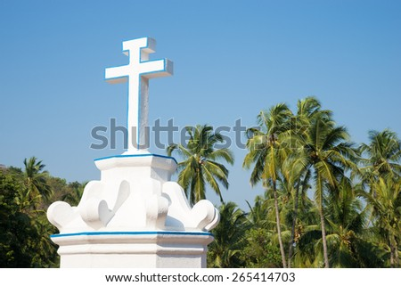Cross and palm trees. - stock photo