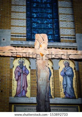 Cross and Saints. Exterior of  Saint-Honore-d'Eylau church in Paris. - stock photo