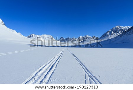 Cross county skiing tracks in a beautiful mountain landscape. - stock photo