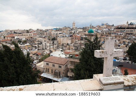 Cross in the foreground and cityscape of Jerusalem - Israel - stock photo